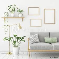 three frames poster mock up in scandinavian livingroom interior