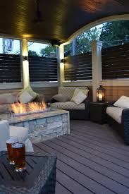 arched veranda firepit lounge seating lighting outdoor rooms