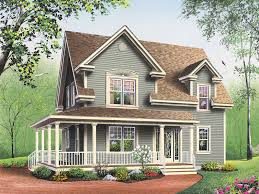 farmhouse with wrap around porch amberly bay farmhouse plan 032d 0017 house plans and more