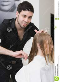 hairdresser dividing client u0027s hair before haircut at salon royalty