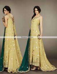 wedding wear dresses bridal mehndi wear yellow back trail pishwas