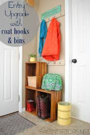 easy entry upgrade with diy built in coat hooks and wooden crates