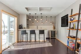 finished walkout basement basement bar area modern basement minneapolis by finished