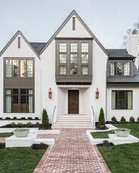 contrasting paint colors and lots of windows beautiful exterior