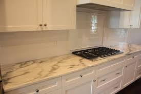 carrara marble countertop minimalist kitchen design with white