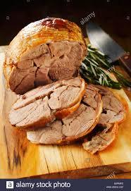 roast leg of lamb slices carved stock photo royalty free image