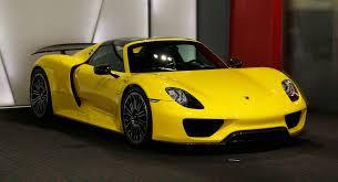 yellow porsche bright yellow porsche 918 spyder could you wince