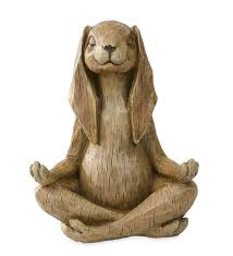 meditating rabbit statue in garden statues