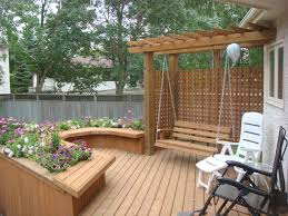 small deck with u shaped bench flower boxes and swing under