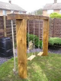 Backyard Swing Set Plans by A Compact Swing Set For The Backyard Could Also Attach A Climbing