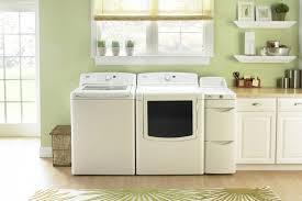 Washer And Dryer Cabinet Between Washer And Dryer Storage Countertops Small Laundry Room