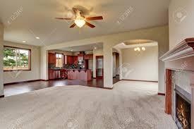 open floor plan living room interior with carpet floor and