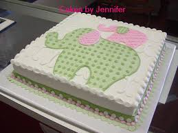 a vanilla sheet cake with grey and navy elephants would be nice i