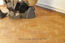 sawdust and resin repair of block parquet floor