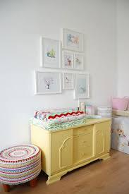 decor8blog pretty pastel prints in white frames repainted deco furniture from