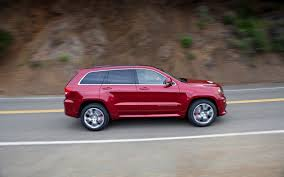 bagged jeep grand cherokee 2012 jeep grand cherokee srt8 first look motor trend