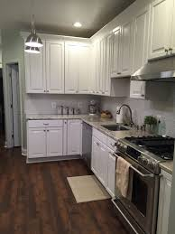 american woodmark kitchen cabinets american woodmark cabinets ge cafe range resilient flooring in a