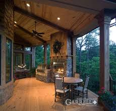 covered porch house plans outdoor fireplace lakeview cottage 05357 garrell associates