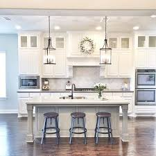 white kitchens with islands lighting above kitchen island