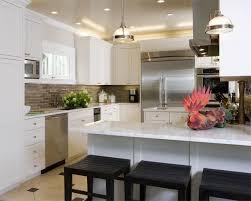 white kitchen cabinets with taupe backsplash chic sophisticated white kitchen cabinets calcutta marble