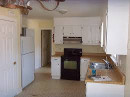 l shaped kitchen design with island also cabinetry with wooden