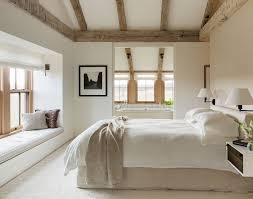 master cathedral high ceiling in master with exposed beams modern farmhouse white and neutral bedroom decor with wooden exposed beams