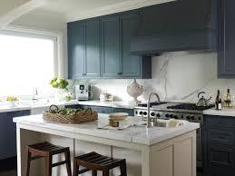 wood countertops navy blue kitchen cabinets lighting flooring sink