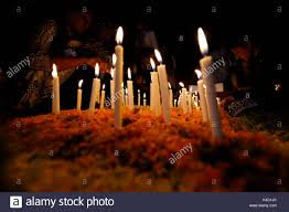 vigil lights catholic church family members light candles and put them on the graves of their