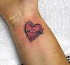 small heart tattoos on arm stiched heart tattoo on wrist tattooed by johnny at the t u2026 flickr