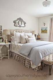 french country style bedroom with pottery barn beige tufted