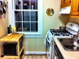 Organizing Kitchen Cabinets Small Kitchen Small Kitchen With White Frame Windows Also White Gas Stove