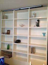 furniture in wall book shelves which furnished with floating