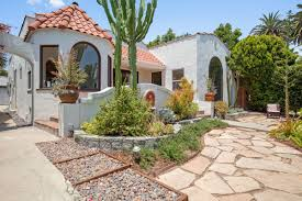 stylehouse spanish style house with sun room asks 719k in mid city curbed la