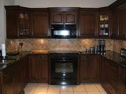backsplash for dark cabinets and dark countertops brown kitchen cabinets with dark countertop and lighter colored tile