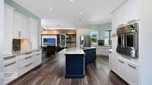 off white kitchen with blue island cabinets omega ellajanegoeppinger