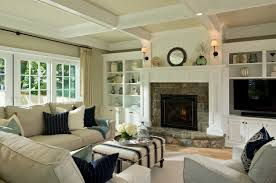 fascinating living room with stone fireplaced between shelf and