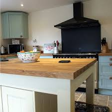 freestanding kitchen island with oak worktop built to match the