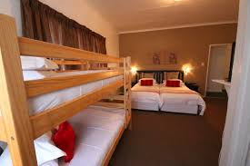 may all who enter as guests leave as friends family room with twin beds and double bunk bathroom with shower in bath mini