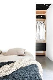 closet behind bed bedroom with walk in closet behind bed maja by deko up interiors