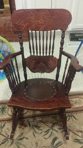 Antique Pressed Back Rocking Chair I Have A Chair My Grandfather Gave Me It Has A Carved Devil Face