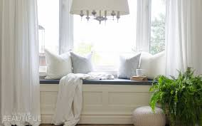 diy window bench with storage a burst of beautiful a diy window bench with storage adds character and charm to a simple window nook
