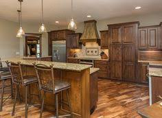 acacia floors with alder cabinets knotty alder cabinets custom