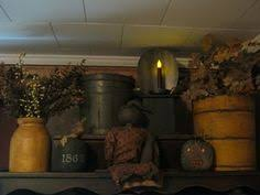 primitive decor above cabinets another pinner says