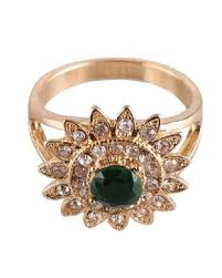 golden flower rings images F 7861 golden metal flower ring with green stone price in jpg