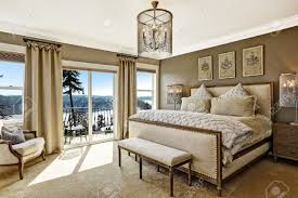 luxury bedroom interior with rich furniture and scenic view from