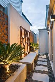 Backyard Wall Fences With Flair Decorative Metal Panels Allowed To Rust