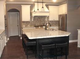 stone backsplash for kitchen kitchen wood look tile dark island white cabinets light granite