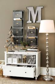 best 25 small office design ideas on pinterest home study rooms a bookshelf file storage and wall pockets turn a small sliver of wall into