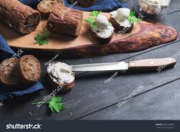 rye bread canapes on black wooden background small stock photo 384144004
