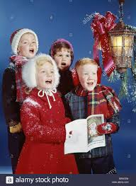 children carolers singing christmas carols at the little venice